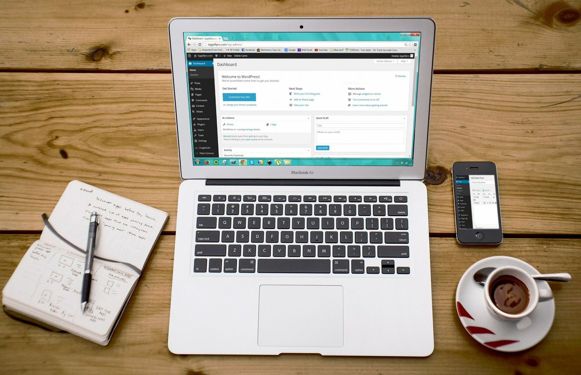A laptop with WordPress open and ready for adding website content.